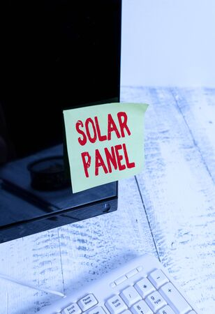 Word writing text Solar Panel. Business photo showcasing designed to absorb suns rays source of energy generating Notation paper taped to black computer monitor screen near white keyboard Banco de Imagens