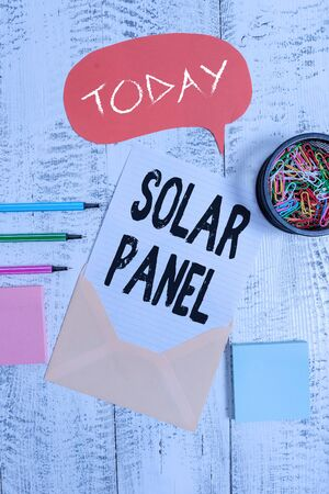 Word writing text Solar Panel. Business photo showcasing designed to absorb suns rays source of energy generating Envelop speech bubble paper sheet ballpoints notepads clips wooden back Banco de Imagens