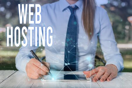 Conceptual hand writing showing Web Hosting. Concept meaning The activity of providing storage space and access for websites Female human wear formal work suit presenting smart device