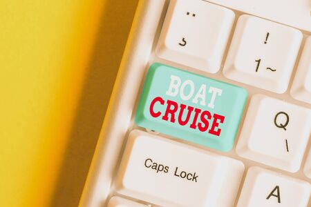 Writing note showing Boat Cruise. Business concept for sail about in area without precise destination with large ship White pc keyboard with note paper above the white background Stock Photo