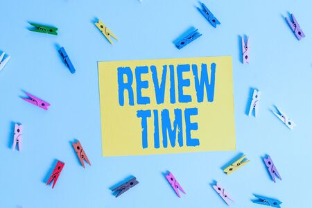 Handwriting text Review Time. Conceptual photo situation or system its formal examination by showing authority Colored clothespin rectangle shaped reminder paper light blue background Фото со стока