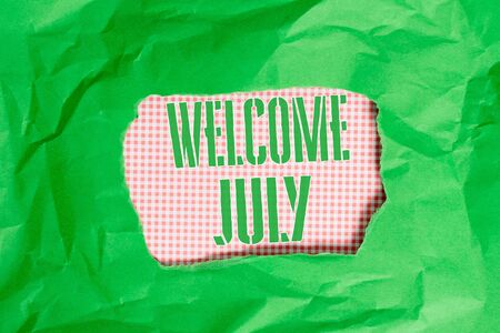 Text sign showing Welcome July. Business photo showcasing Calendar Seventh Month 31days Third Quarter New Season Green crumpled ripped colored paper sheet centre torn colorful background