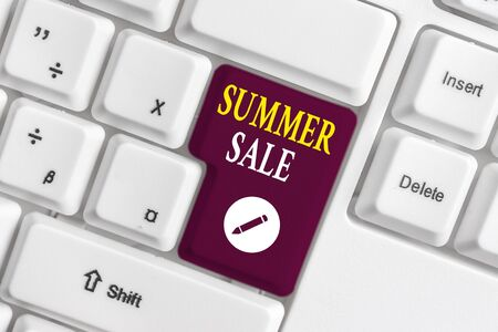 Handwriting text writing Summer Sale. Conceptual photo Annual discount events that takes place during summer season White pc keyboard with empty note paper above white background key copy space 写真素材