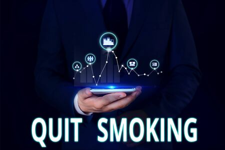Text sign showing Quit Smoking. Business photo showcasing Discontinuing or stopping the use of tobacco addiction Male human wear formal work suit presenting presentation using smart device 写真素材