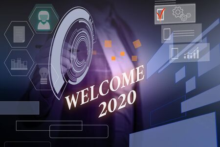 Word writing text Welcome 2020. Business photo showcasing New Year Celebration Motivation to Start Cheers Congratulations Woman wear formal work suit presenting presentation using smart device 스톡 콘텐츠