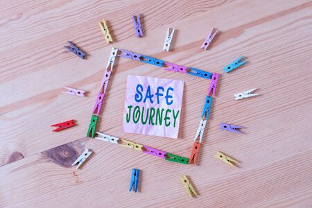 Text sign showing Safe Journey. Business photo showcasing Blessing Bid farewell Drive carefully Use seatbelt Strap Colored clothespin papers empty reminder wooden floor background office 版權商用圖片