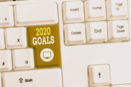 Text sign showing 2020 Goals. Business photo text A plan to do for something new and better for the coming year White pc keyboard with empty note paper above white background key copy space