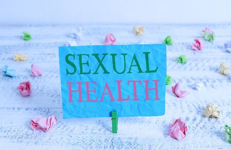 Word writing text Sexual Health. Business photo showcasing Healthier body Satisfying Sexual life Positive relationships Green clothespin white wood background colored paper reminder office supply