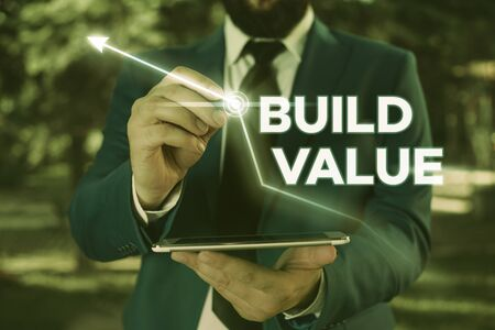 Writing note showing Build Value. Business concept for efficient enough way that it will generate profit after cost