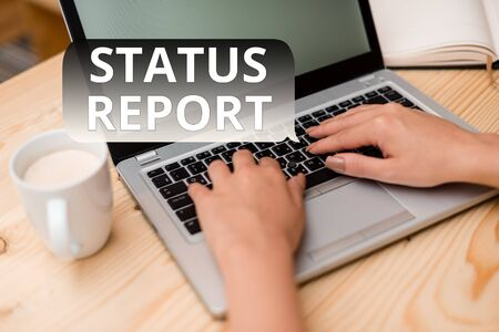 Text sign showing Status Report. Business photo showcasing Update Summary of situations as of a period of time woman laptop computer smartphone mug office supplies technological devices