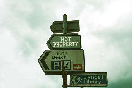 Text sign showing Hot Property. Business photo text Something which is sought after or is Heavily Deanalysisded Empty street signs on the crossroads with blank copy space Stockfoto