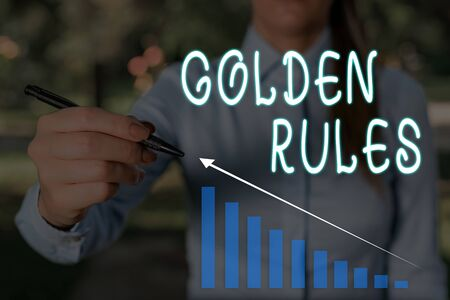 Conceptual hand writing showing Golden Rules. Concept meaning Basic principle that should be followed Important Principle Woman wear work suit presenting presentation smart device