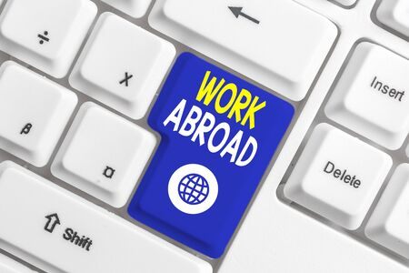 Writing note showing Work Abroad. Business concept for Immersed in a foreign work environment Job Overseas Non Local White pc keyboard with note paper above the white background