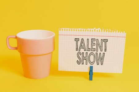 Writing note showing Talent Show. Business concept for Competition of entertainers show casting their perforanalysisces Cup empty paper blue clothespin rectangle shaped reminder yellow office