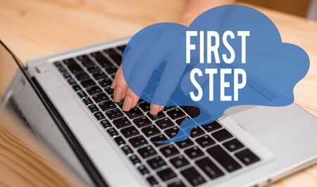 Conceptual hand writing showing First Step. Concept meaning Pertaining to the start of a certain process or beginning woman with laptop smartphone and office supplies technology