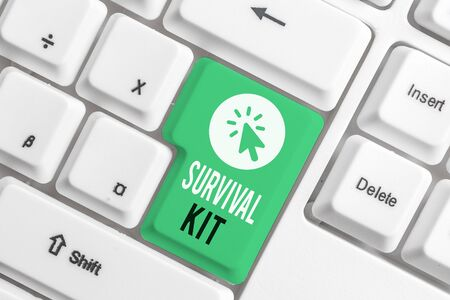 Writing note showing Survival Kit. Business concept for Emergency Equipment Collection of items to help someone White pc keyboard with note paper above the white background Standard-Bild - 131605386