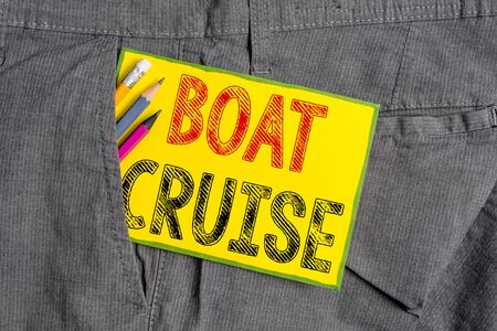 Handwriting text writing Boat Cruise. Conceptual photo sail about in area without precise destination with large ship Writing equipment and yellow note paper inside pocket of man work trousers