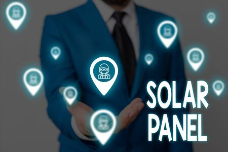 Handwriting text Solar Panel. Conceptual photo designed to absorb suns rays source of energy generating Male human wear formal work suit presenting presentation using smart device Banco de Imagens