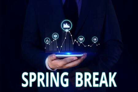 Text sign showing Spring Break. Business photo showcasing Vacation period at school and universities during spring Male human wear formal work suit presenting presentation using smart device