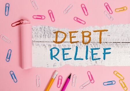 Writing note showing Debt Relief. Business concept for partial or total remission of it especially those by countries