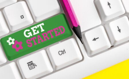 Conceptual hand writing showing Get Started. Concept meaning asking someone to begin task endeavour or process right now White pc keyboard with note paper above the white background Stok Fotoğraf
