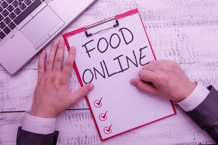 Handwriting text writing Food Online. Conceptual photo asking for something to eat using phone app or website