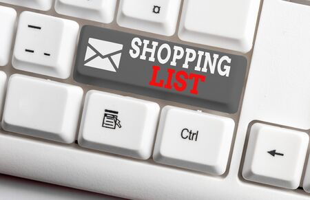 Conceptual hand writing showing Shopping List. Concept meaning Discipline approach to shopping Basic Items to Buy White pc keyboard with note paper above the white background Stok Fotoğraf