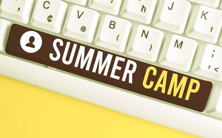 Word writing text Summer Camp. Business photo showcasing Supervised program for kids and teenagers during summertime. White pc keyboard with empty note paper above white background key copy space Stok Fotoğraf