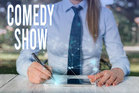Conceptual hand writing showing Comedy Show. Concept meaning Funny program Humorous Amusing medium of Entertainment Female human wear formal work suit presenting smart device