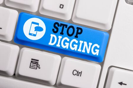 Conceptual hand writing showing Stop Digging. Concept meaning Prevent Illegal excavation quarry Environment Conservation Keyboard with note paper on white background key copy space