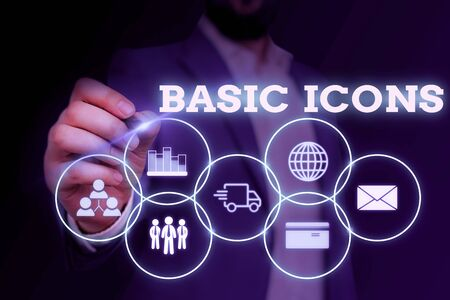 Handwriting text writing Basic Icons. Conceptual photo pictogram or ideogram displayed on a computer screen or phone Male human wear formal work suit presenting presentation using smart device