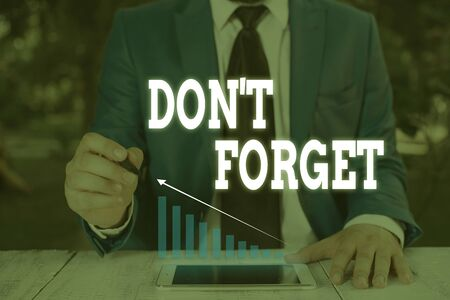 Handwriting text writing Don T Forget. Conceptual photo Know by Heart Think Back Fix in the Mind Refresh Memory Male human wear formal work suit presenting presentation using smart device