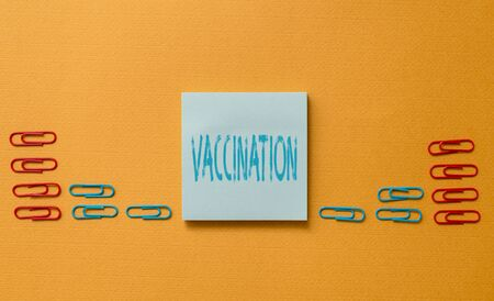 Word writing text Vaccination. Business photo showcasing Treatment which makes the body stronger against infection Colored blank sticky note clips gathered trendy cool pastel background