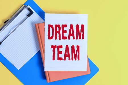 Word writing text Dream Team. Business photo showcasing Prefered unit or group that make the best out of a demonstrating Pile of empty papers with copy space on the table