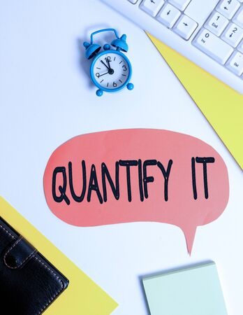 Word writing text Quantify It. Business photo showcasing Measure the size or amount of something and express in numbers Flat lay with copy space on bubble paper clock and paper clips Stock fotó