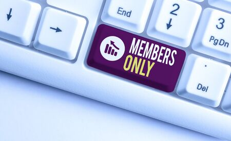 Writing note showing Members Only. Business concept for Limited to an individual belongs to a group or an organization White pc keyboard with note paper above the white background