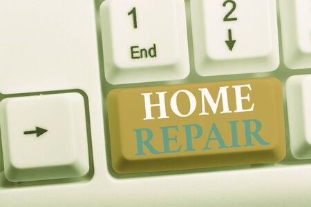 Writing note showing Home Repair. Business concept for maintenance or improving your own house by yourself using tools White pc keyboard with note paper above the white background