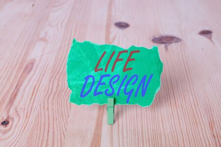 Text sign showing Life Design. Business photo showcasing balance how you live between work family and entertaining Empty reminder wooden floor background green clothespin groove slot office Фото со стока