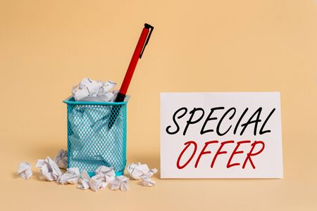 Text sign showing Special Offer. Business photo showcasing Discounted price Markdown Promotional Items Crazy Sale crumpled paper trash and stationary with note paper placed in the trash can