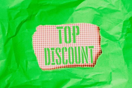 Text sign showing Top Discount. Business photo showcasing Best Price Guaranteed Hot Items Crazy Sale Promotions Green crumpled ripped colored paper sheet centre torn colorful background