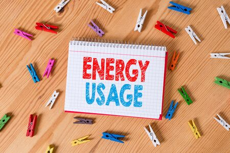 Conceptual hand writing showing Energy Usage. Concept meaning Amount of energy consumed or used in a process or system Colored crumpled papers wooden floor background clothespin Zdjęcie Seryjne