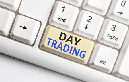 Text sign showing Day Trading. Business photo showcasing securities specifically buying and selling financial instruments White pc keyboard with empty note paper above white background key copy space