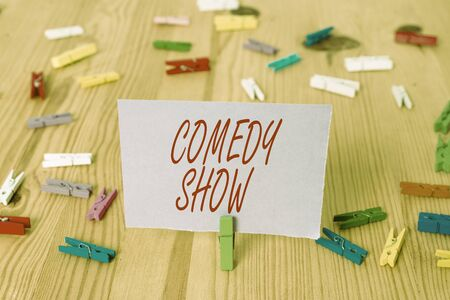 Handwriting text Comedy Show. Conceptual photo Funny program Humorous Amusing medium of Entertainment Colored clothespin papers empty reminder wooden floor background office 写真素材