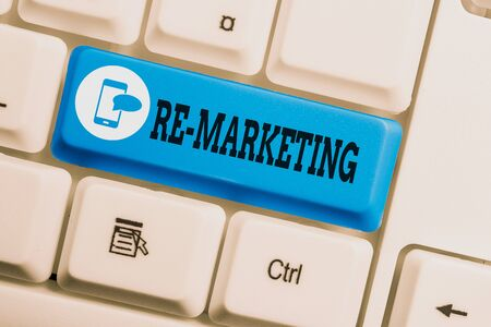 Conceptual hand writing showing Re Marketing. Concept meaning Strategy to reach potential customers in your website Keyboard with note paper on white background key copy space Foto de archivo - 130159905