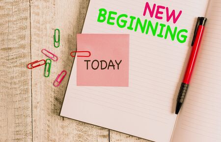 Handwriting text New Beginning. Conceptual photo Different Career or endeavor Starting again Startup Renew Thick pages notebook stationary placed above classic look wooden backdrop