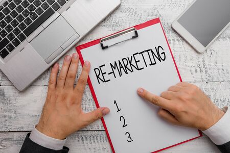 Writing note showing Re Marketing. Business concept for Strategy to reach potential customers in your website