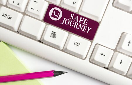 Word writing text Safe Journey. Business photo showcasing Blessing Bid farewell Drive carefully Use seatbelt Strap White pc keyboard with empty note paper above white background key copy space Stok Fotoğraf