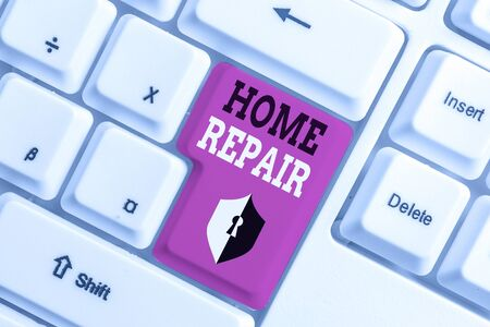 Text sign showing Home Repair. Business photo text maintenance or improving your own house by yourself using tools White pc keyboard with empty note paper above white background key copy space