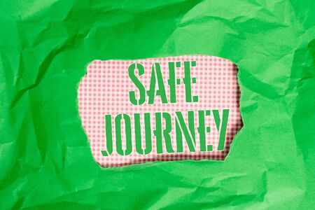 Text sign showing Safe Journey. Business photo showcasing Blessing Bid farewell Drive carefully Use seatbelt Strap Green crumpled ripped colored paper sheet centre torn colorful background Stok Fotoğraf