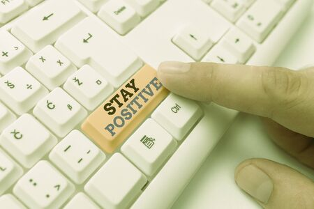 Text sign showing Stay Positive. Business photo showcasing Engage in Uplifting Thoughts Be Optimistic and Real White pc keyboard with empty note paper above white background key copy space